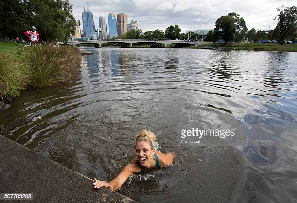 In this handout photo provided by Tennis Australia Angelique Kerber of Germany jumps into the Yarra River on day 14 of the 2016 Australian Open at...