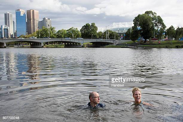 In this handout photo provided by Tennis Australia, Angelique Kerber of Germany jumps into the Yarra River on day 14 of the 2016 Australian Open at...
