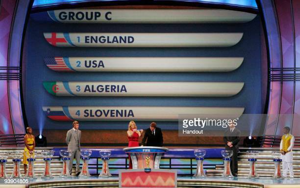 In this handout photo provided by the 2010 FIFA World Cup Organising Committee, FIFA Secretary General Jérôme Valcke holds the name of England...