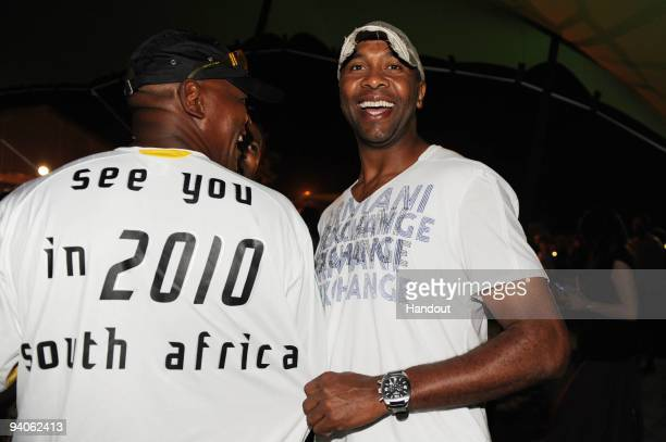 In this handout photo provided by the 2010 FIFA World Cup Organising Committee Lucas Radebe attends the World Press Day Beach Party on December 5...