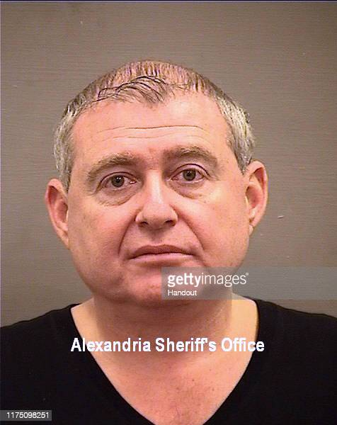 In this handout photo provided by the Alexandria Virginia Sheriff's Office Lev Parnas poses for a booking photo October 9 2019 in Alexandria Virginia...