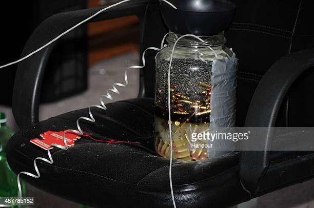 In this handout photo provided by the Arapahoe County District Attorneys Office homemade explosives are arranged in James Holmes' apartment circa...