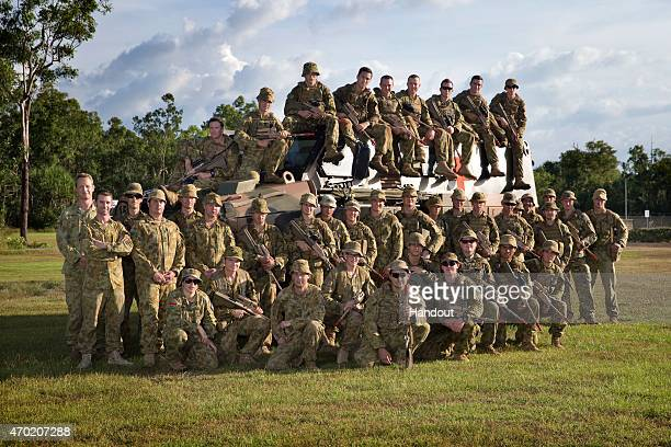 In this handout photo provided by the Australian Defence Force Prince Harry poses with the participants of Exercise Thunder Observer a Joint Fire...
