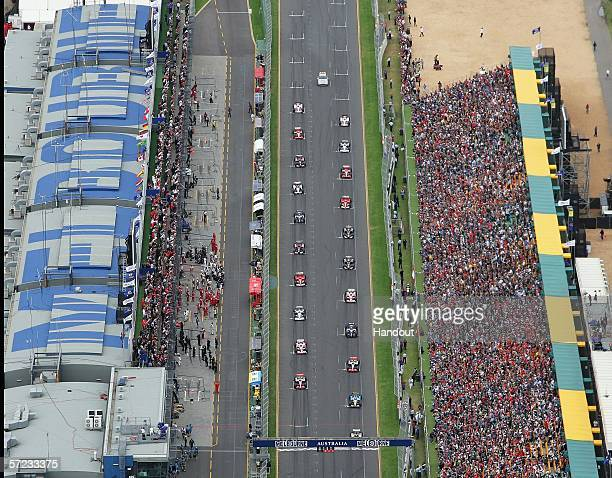 In this handout photo provided by the Australian Grand Prix Corporation cars leave the starting grid during the Australian Formula One Grand Prix at...