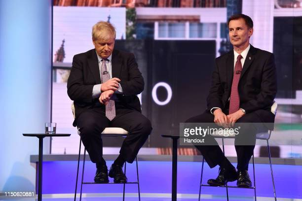 In this handout photo provided by the BBC MP Boris Johnson and Secretary of State for Foreign Affairs Jeremy Hunt participate in a Conservative...