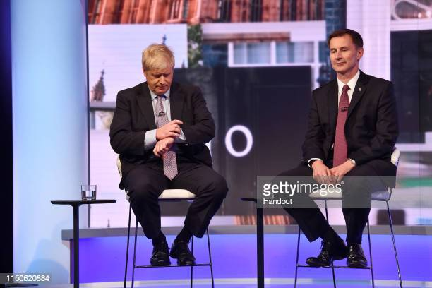 In this handout photo provided by the BBC, MP Boris Johnson and Secretary of State for Foreign Affairs Jeremy Hunt participate in a Conservative...
