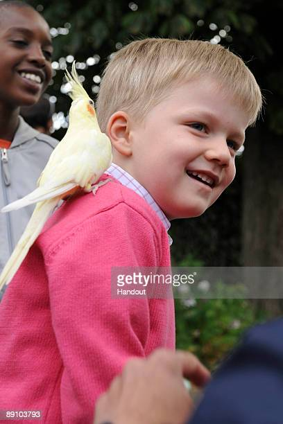 In this handout photo provided by the Belgian Royal Palace Prince Gabriel of Belgium holds a baby goat as he attends a Summer Photocall at Paradisio...