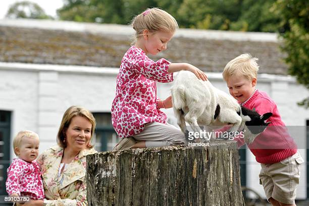 In this handout photo provided by the Belgian Royal Palace Princess Elizabeth of Belgium feeds a baby goat as she attends a Summer Photocall at...