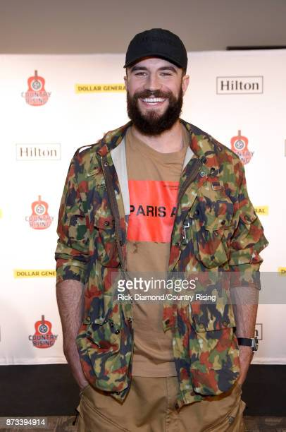 In this handout photo provided by The Country Rising Fund of The Community Foundation of Middle Tennessee singer Sam Hunt poses backstage for the...