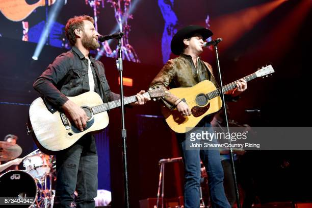In this handout photo provided by The Country Rising Fund of The Community Foundation of Middle Tennessee Musical artists Dierks Bentley and Jon...