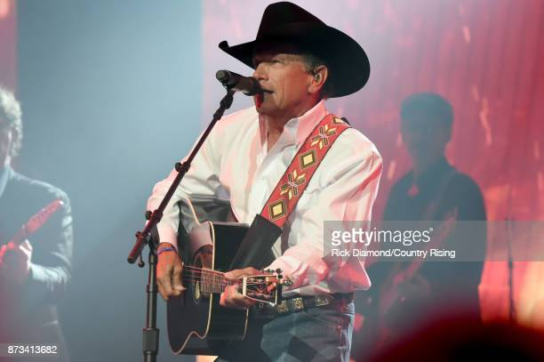 In this handout photo provided by The Country Rising Fund of The Community Foundation of Middle Tennessee singersongwriter George Strait performs...