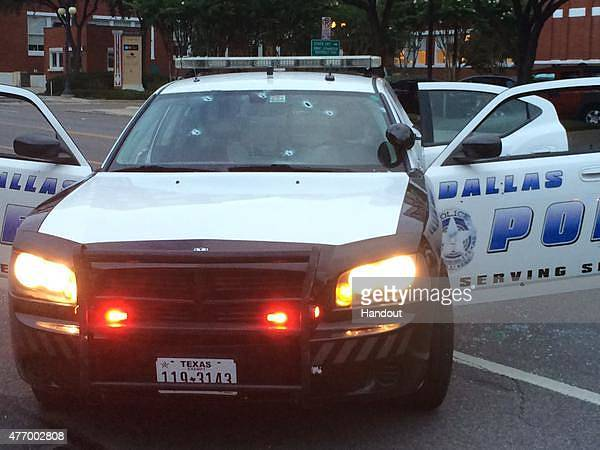 In this handout photo provided by the Dallas Police Department bullet holes are seen in the glass windows of a police cruiser on June 13 2015 in...