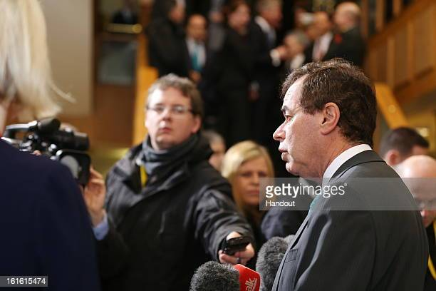 In this handout photo provided by the Dept of the Taoiseach, Ireland's Minister for Justice, Equality and Defence, Alan Shatter TD talks to the press...