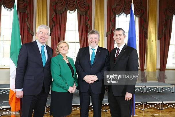 In this handout photo provided by the Dept of the Taoiseach Ireland's Minister for Health Dr James Reilly poses with Alex White TD Minister of State...