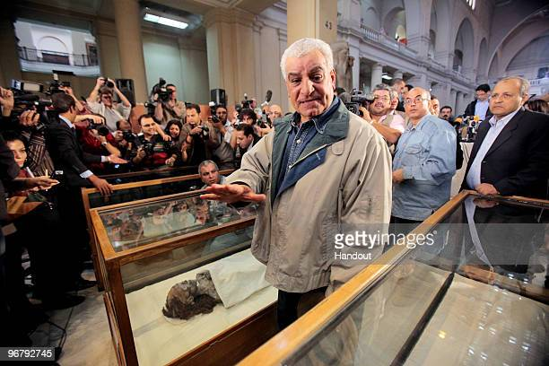 In this handout photo provided by the Discovery Channel Egypt's top archaeologist Zahi Hawass talks to the media next mummies of King Tutankhamun's...