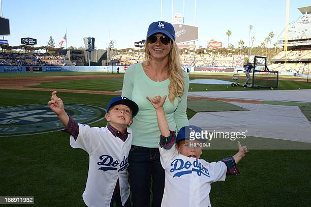 In this handout photo provided by the LA Dodgers Britney Spears poses with sons Jayden James Federline and Sean Preston Federline during agame...