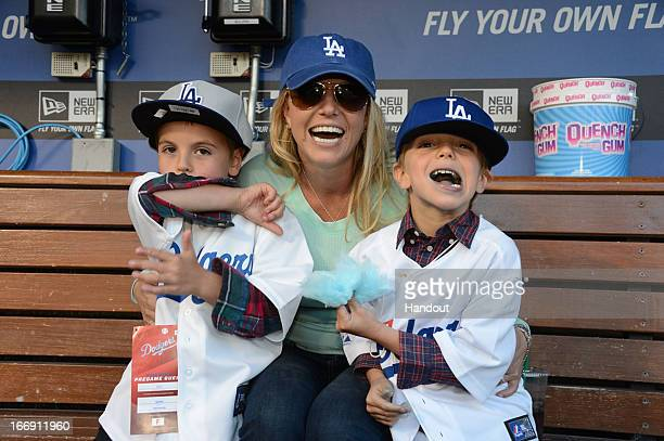 In this handout photo provided by the LA Dodgers Britney Spears poses with sons Sean Preston Federline and Jayden James Federline during agame...