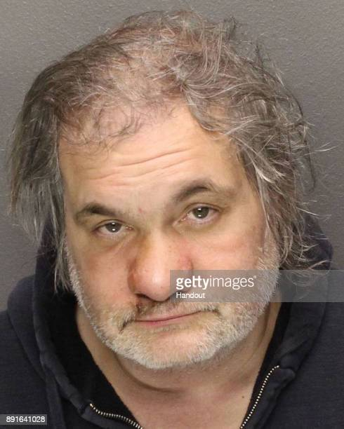 In this handout photo provided by the Essex County Sheriff Comedian and radio personality Artie Lange poses for his mugshot after being arrested for...