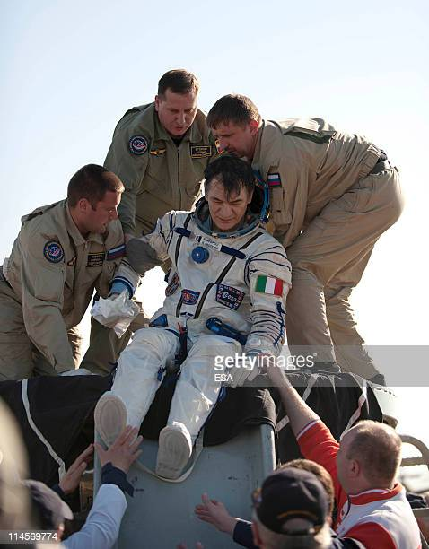 In this handout photo provided by the European Space Agency , ESA astronaut Paolo Nespoli is helped after landing back on Earth from their Soyuz...