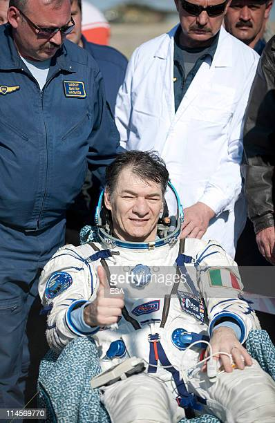 In this handout photo provided by the European Space Agency , ESA astronaut Paolo Nespoli looks on after landing back on Earth from their Soyuz...