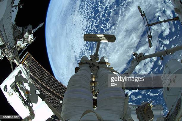 In this handout photo provided by the European Space Agency , German ESA astronaut Alexander Gerst takes a photo during his spacewalk, whilst aboard...