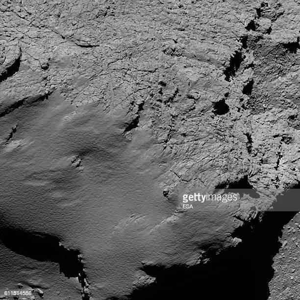 In this handout photo provided by the European Space Agency Rosettas OSIRIS narrowangle camera captured this image of Comet 67P/ChuryumovGerasimenko...