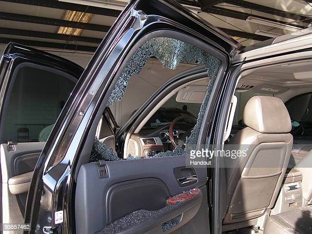 In this handout photo provided by The Florida Highway Patrol a broken window from the vehicle driven by Tiger Woods during his accident is seen on...