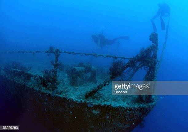 In this handout photo provided by the Florida Keys News Bureau divers swim at the shipwreck Spiegel Grove in the Florida Keys National Marine...
