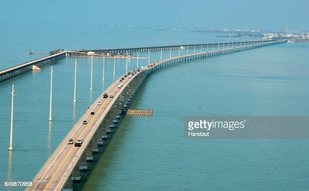 In this handout photo provided by the Florida Keys News Bureau traffic rolls on the Seven Mile Bridge on September 19 2017 in Marathon Florida Early...