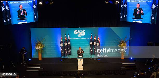 In this handout photo provided by the G20 Australia Australian Prime Minister Tony Abbott addresses the media at a press conference at the conclusion...