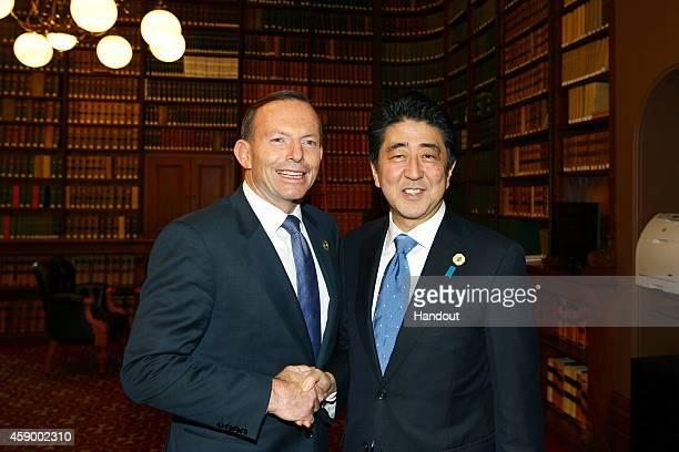 In this handout photo provided by the G20 Australia Australia's Prime Minister Tony Abbott greets Japan's Prime Minister Shinzo Abe in the Reading...