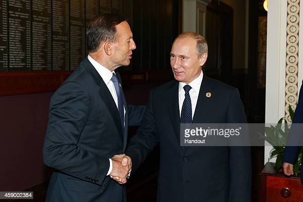 In this handout photo provided by the G20 Australia, Australia's Prime Minister Tony Abbott greets Russia's President Vladimir Putin in the Reading...