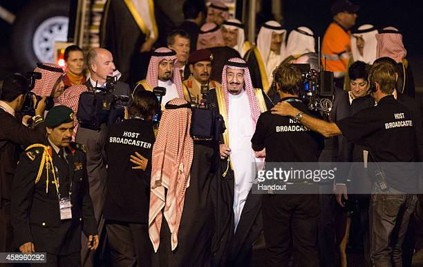 In this handout photo provided by the G20 Australia Crown Prince Salman bin Abdulaziz Al Saud of Saudi Arabia arrives at the G20 Terminal on November...