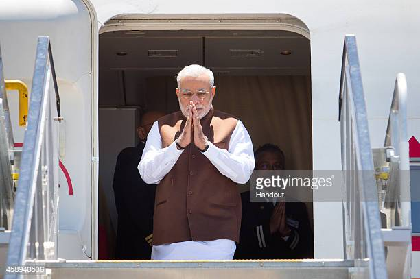 In this handout photo provided by the G20 Australia Indian Prime Minister Narendra Modi arrives at the Brisbane G20 Terminal on November 14 2014 in...
