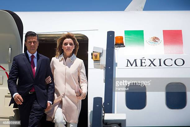 In this handout photo provided by the G20 Australia Mexico's President Enrique Pena Nieto and First Lady Angelica Rivera Hurtado arrive at G20...