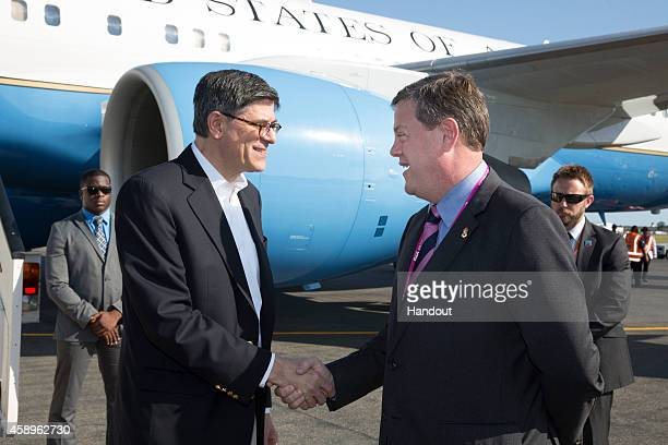 In this handout photo provided by the G20 Australia United States' Secretary of the Treasury Jacob Lew is welcomed by Queensland's Treasurer and...