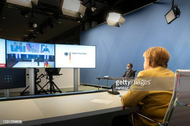 In this handout photo provided by the German Chancellor Angela Merkel during a video conference in the Federal Chancellery as part of the Munich...