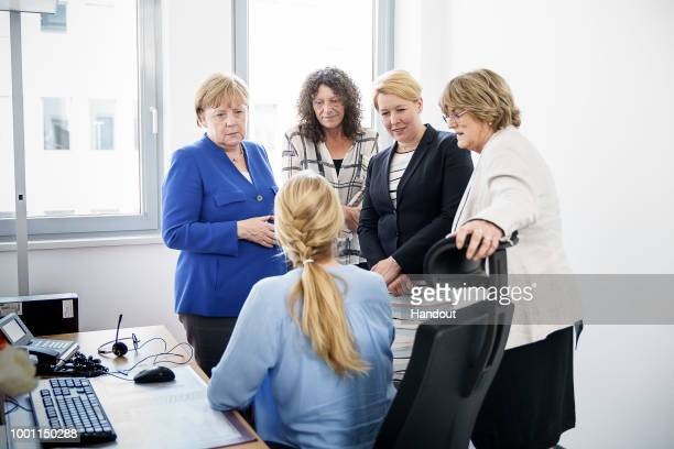 In this handout photo provided by the German Government Press Office German Chancellor Angela Merkel Petra Söchting Referatsleiterin Hilfetelefon...