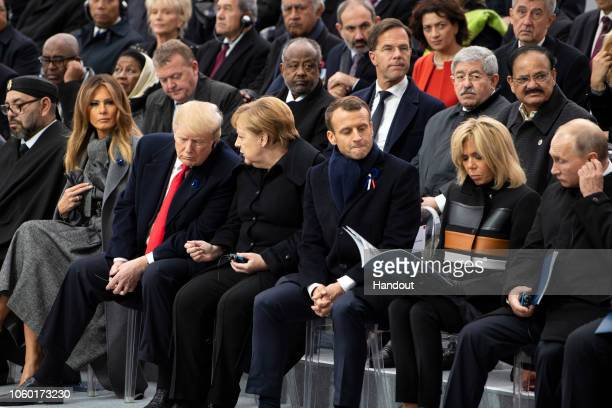 In this handout photo provided by the German Government Press Office US First Lady Melania Trump US President Donald Trump German Chancellor Angela...