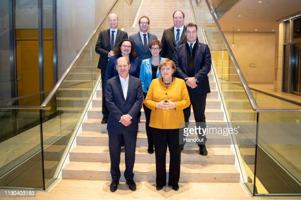 In this handout photo provided by the German Government Press Office the Coalition Committee of the CDU SPD and CSU in the German Bundestag pose for...