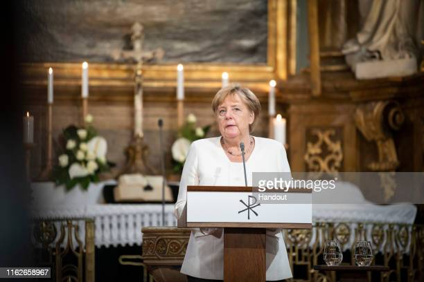 In this handout photo provided by the German Government Press Office German Chancellor Angela Merkel makes a speech during an ecumenical church...