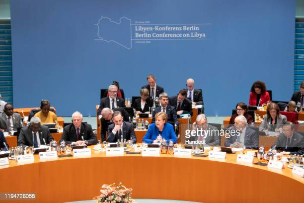 In this handout photo provided by the German Government Press Office , German Chancellor Angela Merkel , German Foreign Minister Heiko Maas , EU...