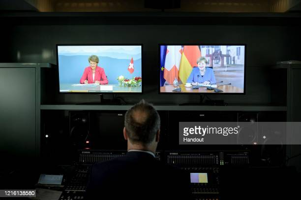 In this handout photo provided by the German Government Press Office German Chancellor Angela Merkel is seen during a video conference with...