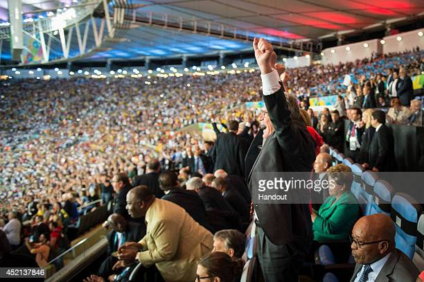 In this handout photo provided by the German Government Press Office German President Joachim Gauck celebrates after the 2014 FIFA World Cup Brazil...