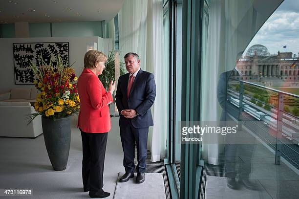 In this handout photo provided by the German Government Press Office , German Chancellor Angela Merkel and King Abdullah of Jordan meet before their...