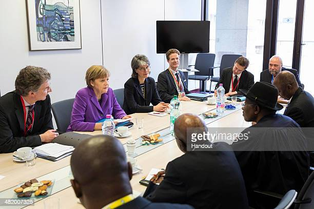 In this handout photo provided by the German Government Press Office German Chancellor Angela Merkel speaks with President of Nigeria Goodluck...