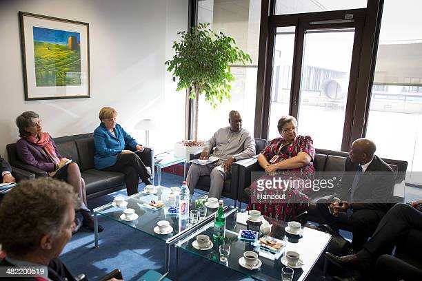 In this handout photo provided by the German Government Press Office German Chancellor Angela Merkel meets with President of Ghana John Dramani...