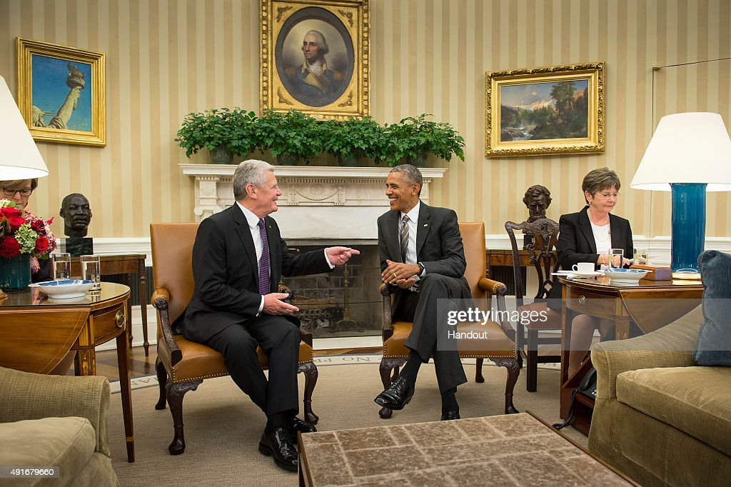 In this handout photo provided by the German Government Press Office (BPA), US President Barack Obama (R) listens to German President Joachim Gauck speak during a meeting in the Oval Office at the White House on October 7, 2015 in Washington, DC. The two leaders participated in a bi lateral meeting that marked the 25th anniversary of German reunification.
