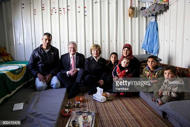 In this handout photo provided by the German Government Press Office German President Joachim Gauck and his partner Daniela Schadt speak with a...