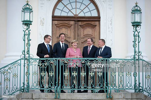 In this handout photo provided by the German Government Press Office German Chancellor Angela Merkel receives Finnish Prime Minister Juha Sipila...